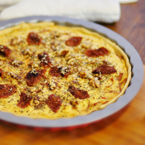 Quiche de requesón, tomates secos y nueces